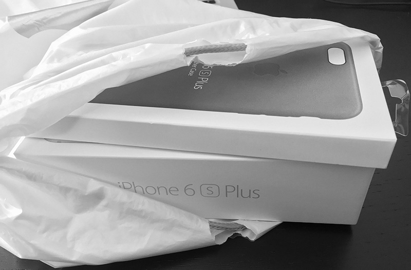 Photo of iPhone 6S Plus and companion leather case, re-boxed and in an Apple bag
