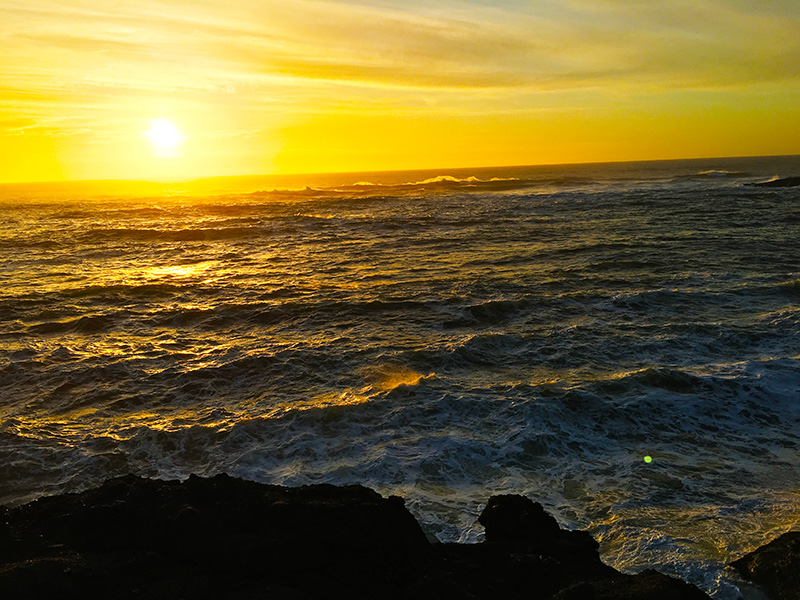 Sun setting over Oregon's western coast